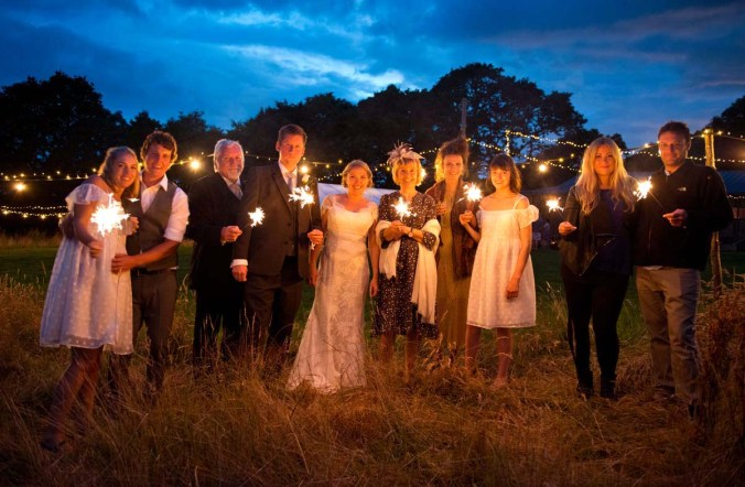 """wedding group with sparklers"""